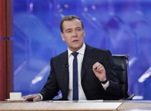 Russia's Prime Minister Dmitry Medvedev speaks during his interview with national television channels in Moscow